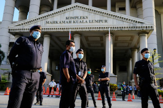Police guard the entrance of the court complex in Kuala Lumpur on Tuesday.