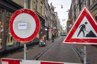 A street closed off because of construction work on the canal walls at loveniersburgwal in Amsterdam.