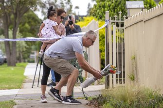 Warrick visited the scene with his wife and daughter to lay flowers on Friday morning.