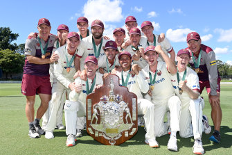The Queensland team celebrates victory during day four of the Sheffield Shield Final.