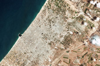 This satellite photo released by Planet Labs shows the damage on the Gaza Strip on Thursday.