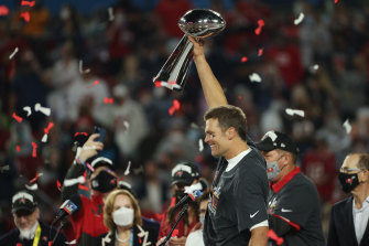 Tampa Bay quarterback Tom Brady celebrates with the Lombardi Trophy after his team won 31-9 over the Kansas City Chiefs