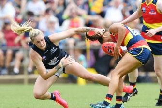 Harris tackles Justine Mules of the Adelaide Crows during the Round 4 AFLW match at Richmond Oval in Adelaide, March 1, 2020.
