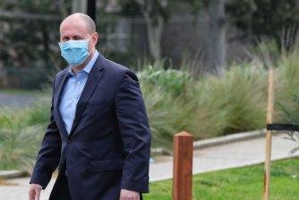 Treasurer Josh Frydenberg masks up in Melbourne on Saturday.