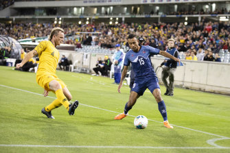 Australia's Rhyan Grant corners Nepal's Sujal Shreshtha during the Socceroos' 5-0 World Cup qualifying victory in October.