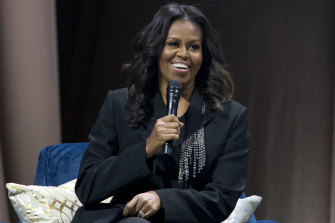 Michelle Obama in Washington wearing a black crystal-embellished suit by Christopher Kane.