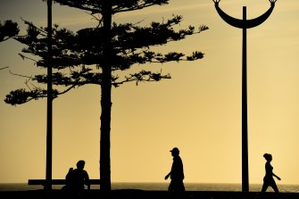 People exercising at Maroubra Beach. A party in the beachside suburb has led to 81 infections.