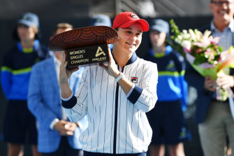 Ashleigh Barty lifts the trophy after winning the Adelaide International women's final on Saturday.