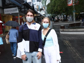Luca Aroney and Lauren Chadlowe shopping for masks in Chatswood.