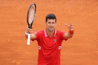 Back in action: Novak Djokovic celebrates his win.