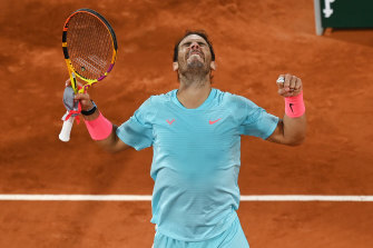 Rafael Nadal celebrates after a tough victory over young Italian Jannik Sinner.