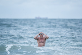 Brrr: Peter Brydon went for a dip at Middle Park beach on Friday morning.