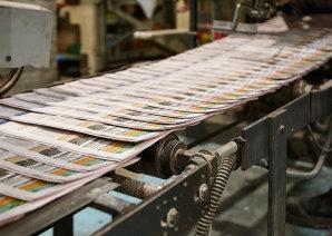 A community newspaper print run.