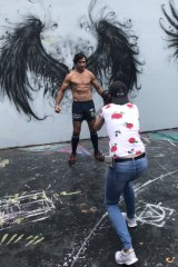 Annette Dew getting the perfect picture of Thurston with his supersized wings.