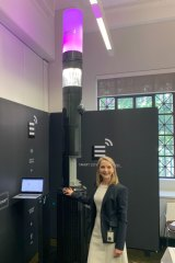 Brisbane City Council infrastructure committee chairwoman Amanda Cooper at City Hall with one of the new smart poles about to be trialled in Brisbane.