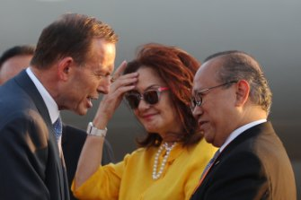 Nadjib Riphat Kesoema (right) welcomes Tony Abbott to Bali in 2013.
