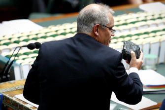 Then Treasurer Scott Morrison holds up a lump of coal during Question Time at Parliament House in February 2017.
