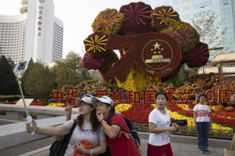 Selfie time, in front a floral docration for the 70th party in Beijing.