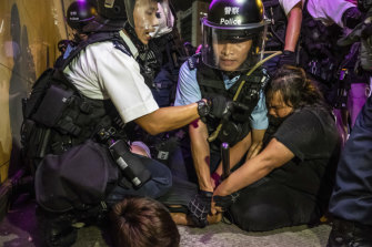 Police officers mark arrests in the Sha Tin district of Hong Kong, July 14, 2019