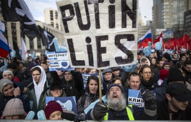 Demonstrators at the Free Internet rally in Moscow protest against a Russian government bill calling for all internet traffic to be routed through servers in Russia – making VPNs ineffective.