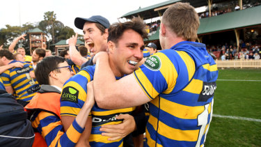 Grassroots: Sydney University star Nick Phipps celebrates winning this year's Shute Shield grand final.