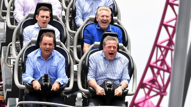 Queensland Opposition Leader Tim Nicholls (bottom right) takes a ride on the DC Rivals Hypercoaster at the Movie World theme park on the Gold Coast.