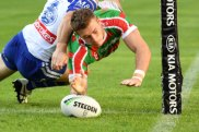 Starting early: Souths winger Campbell Graham crashes over in the opening minutes.