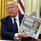 President Donald Trump holds up a copy of the New York Post as speaks before signing an executive order aimed at curbing protections for social media giants, in the Oval Office.