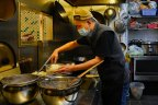 Staff at Nanjing Dumpling restaurant prepare food in Sydney's Chinatown on Friday.