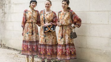 Three women who arrived at the Gorman fashion parade at Heide wearing the same dress.