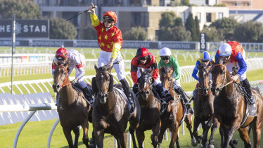 James McDonald salutes after piloting Captivant to victory in the Champagne Stakes at Royal Randwick Racecourse.