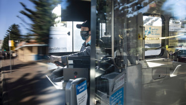 A NSW bus driver wears a homemade face mask whilst working.