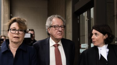 Geoffrey Rush and his wife Jane Menelaus  (left) arrive at the Federal Court on Thursday.