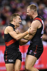 Stringer celebrates with teammate Devon Smith, who has become a close friend.