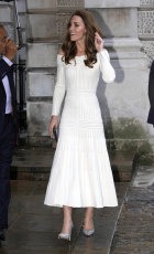 The Duchess of Cambridge arrives for the first annual gala dinner in recognition of Addiction Awareness Week. She wore a white off shoulder Barbara Casasola dress, pairing her look with silver embellished Jimmy Choo heels.