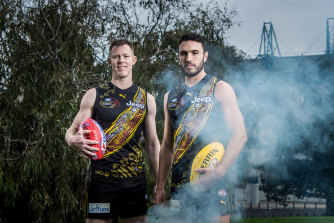 Jack Riewoldt and Shane Edwards  in front of the canoe tree in Yarra Park outside the MCG, wearing the Indigenous jumper they helped design for Sir Doug Nicholls round.