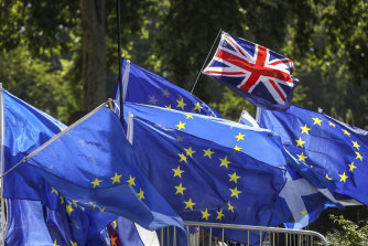 A British flag flies above European Union flags during a demonstration in London.