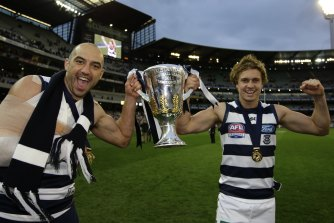 Mitch Duncan (right) is one of four players remaining in Geelong's team from their 2011 premiership side.
