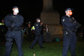 A statue of James Cook was surrounded by police.