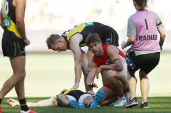 Sydney's Dane Rampe shows concern for Kamdyn McIntosh after the pair collided in Saturday's MCG match.