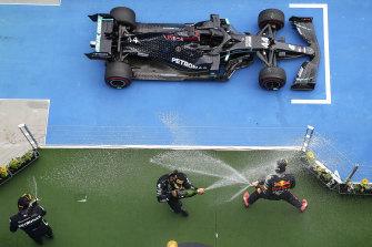 Lewis Hamilton celebrates his win.