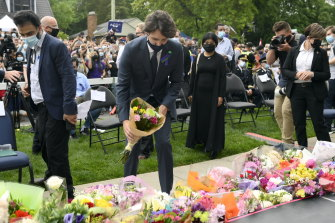 Canada's Prime Minister Justin Trudeau places flowers at a vigil for the victims of the deadly vehicle attack in London, Ontario.