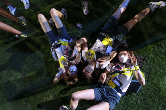 """Athletes enjoying Sunday at """"a Tokyo park"""", just as planned by organisers."""
