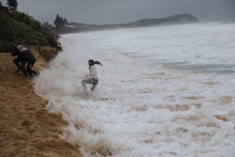 The waves continue to push further inland.