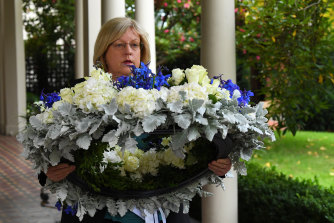 Police Minister Lisa Neville with a wreath of flowers for Leading Senior Constable Lynette Taylor.