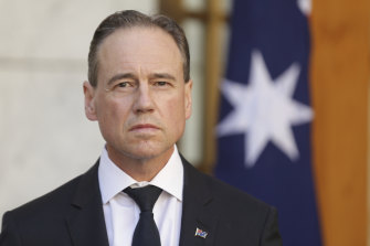 Greg Hunt has linked his hospital-in-the-home shake-up with efforts to reduce health insurers' costs.