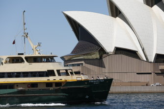 A Freshwater ferry passes the Sydney Opera House ... would the latter have been built had it been subjected to a crude cost-benefit analysis? Yet its economic return for Sydney is not questioned today.