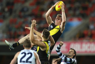 Dylan Grimes flies for a mark against the Cats earlier this year.
