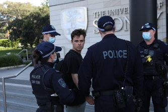 Students and university staff protest at the government's proposed fee rises and the university's staff cuts at the University of Sydney on Wednesday.