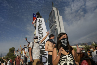 Chilean demonstrators shout slogans during the fifth day of protests against President Sebastian Piñera.